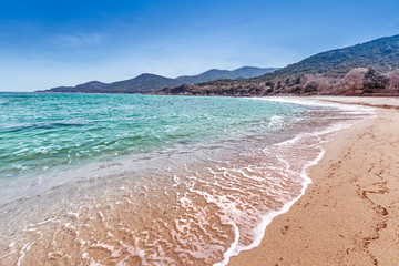 Fascinating Pristine sand beach in Greece. Holiday or vacation background.