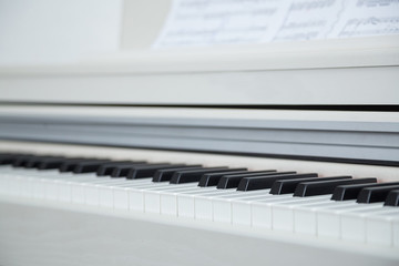 Close up of wooden white piano keys
