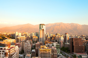 The wealthy neighborhood of Isidora Goyenechea, with El Bosque street and Los Andes Mountain Range in the back, Las Condes district, Santiago, Chile