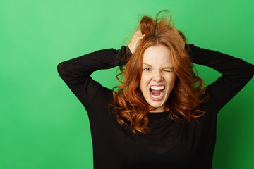 Frustrated redhead woman snarling at the camera