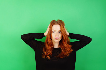 Confused neurotic young redhead woman