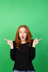 Shocked young redhead woman with her mouth agape