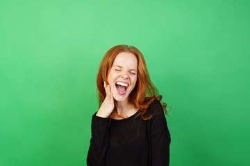 Young woman with red hair laughing