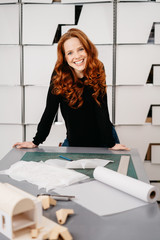Happy friendly woman working in a design studio