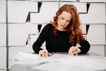 Businesswoman sorting through a pile of papers