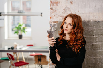 Portrait of beautiful woman holding a mobile phone