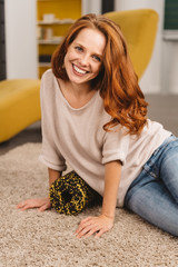 Happy young redhead woman with a vivacious smile