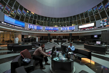 Traders look at the screens at Bahrain Bourse in Manama