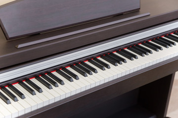 modern wooden black piano in music classrom