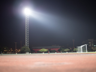 backgrond of soccer stadium at night with spot light.