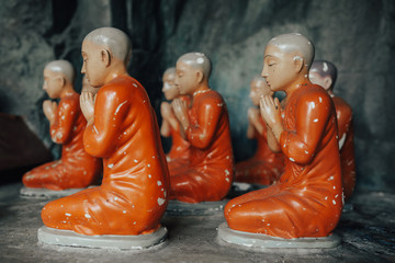 Buddhist monk statue in lotus position.