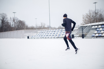 Image of running athlete through stadium