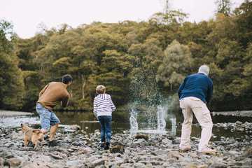 Three Generation Family are Skimming Stones
