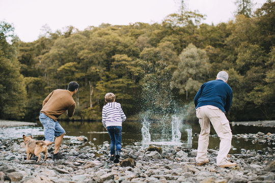 Three Generation Family are Skimming Stones