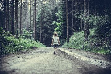 Little Girl Lost in Forest Walking Alone