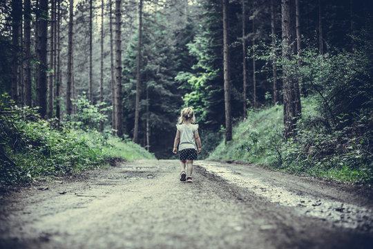 Little Girl Lost in Forest Walking Alone
