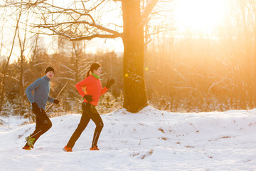 Image of running athletes in winter forest