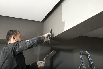 Applying Paint with Plastering Trowel
