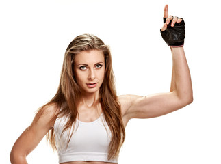 Sportswoman pointing up. Young strong athletic woman in gloves pointing up