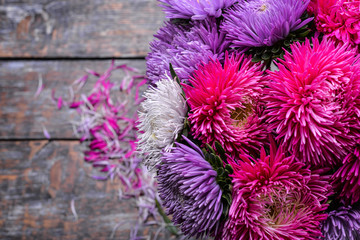 Aster flowers bouquet purple red pink white on a wooden background. selective focus
