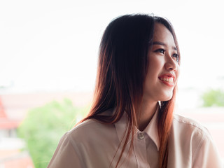student and graduation concept from asian beautiful girl (20s to 30s)with long black hair smile and happiness feeling with asia architecture background