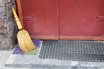 brooms at the threshold