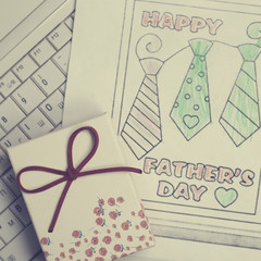 Kid drawing greeting card for for happy father