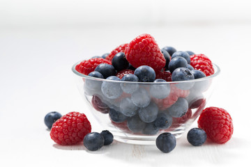 fresh seasonal berries in a glass bowl, closeup