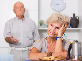 Elderly upset woman having problems in relationship with husband