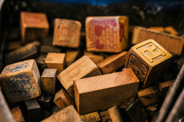 Old wooden cubes with letters