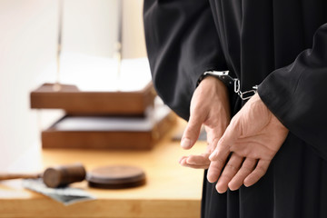 Male judge in handcuffs, closeup