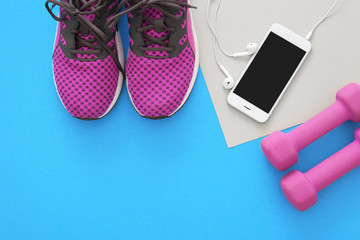 Gym stuff, mobile phone and blank space for exercise plan on color background. Flat lay composition