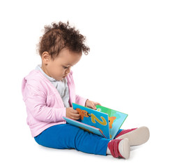 Cute little child with colorful book on white background