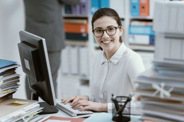 Young secretary working and smiling