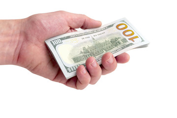 A man gives or takes a pile of hundred-dollar bills. A thousand dollars in hand on a white background. Isolated. Close-up.
