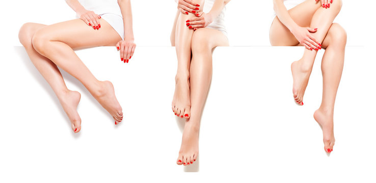 Three beautiful slim womans with red manicure, sitting at banner, isolated on white background