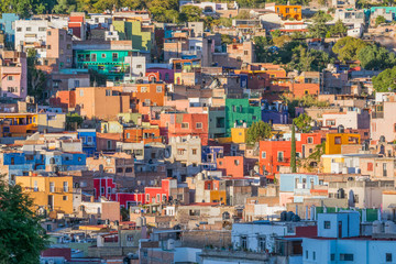 Isolated shot of many colorful houses, dotting the hillside, on a sunny day, In Guanajuato, Mexico
