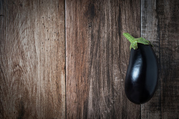 Shiny Eggplant on rustic wooden bacground. Copy space.