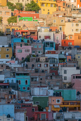 Door stickers Mexico Isolated shot of many colorful houses, dotting the hillside, in Guanajuato, Mexico