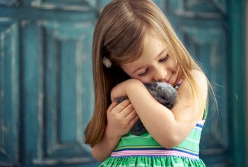 Little girl with baby bunny