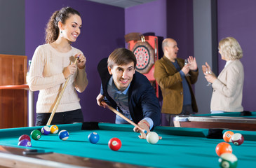 Ordinary people having pool game