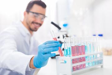 Appealing male laboratorian needs reagent