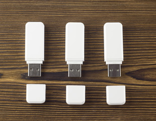 White flash drive on a wooden background