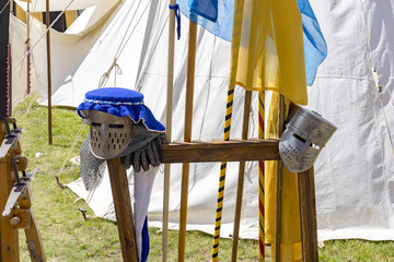 Knight helmets made of metal placed on a wooden frame for the next tournament