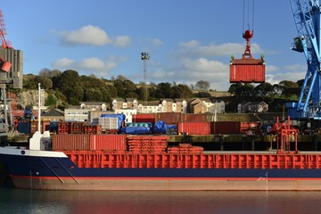 St Helier docks, Jersey, U.K. A container ship being loaded.