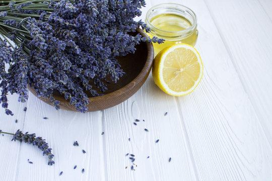 Dry lavender,lemon and honey on the white  wooden background