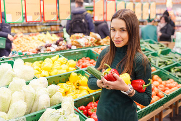 Young woman on the market with vegetables