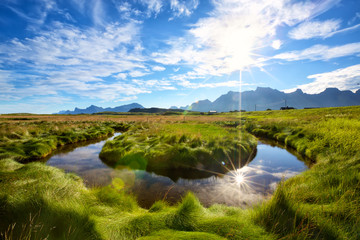 Fotomurales - Small stream meandering through the land in Lofoten Islands, Norway