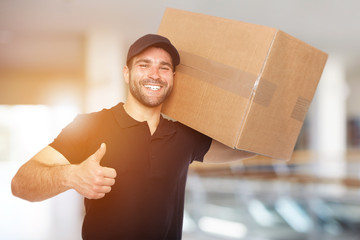 Smiling delivery man with box
