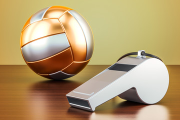 Volleyball ball with whistle on the wooden table, 3D rendering